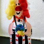 Clowns in Symmetry